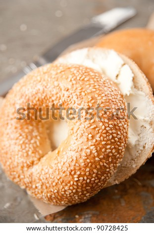 Freshly Baked Sesame Seed and Plain Bagels with Cream Cheese for Breakfast - stock photo