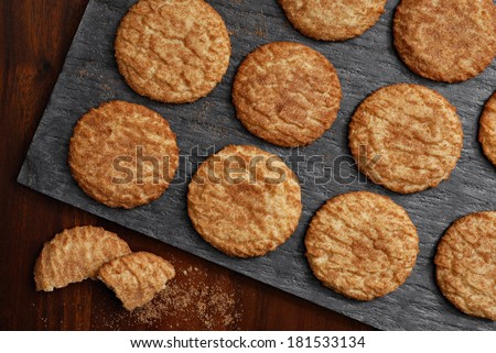 Freshly baked snickerdoodle cookies on slate serving tray as seen from above.  Rustic still life with directional, natural lighting for effect. - stock photo