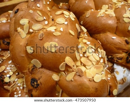 freshly baked sweet pastry with almonds on top
