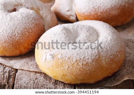 freshly baked sweet rolls ensaimadas with powdered sugar close-up on the table. horizontal - stock photo