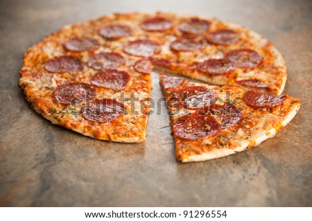 Freshly Baked Thin Crust Pepperoni and Cheese Pizza - stock photo