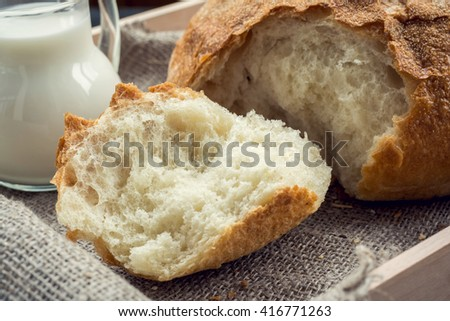 Freshly baked traditional bread on wooden tray
