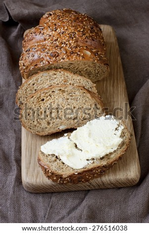 Freshly baked traditional bread with butter cream - stock photo