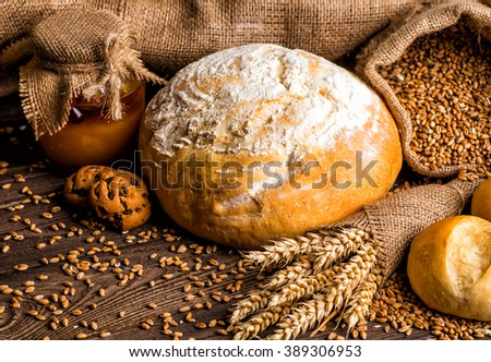 Freshly baked traditional bread with honey on a wooden table