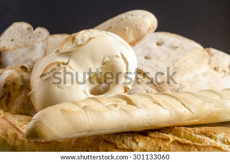 Freshly baked traditional breads on wooden table.