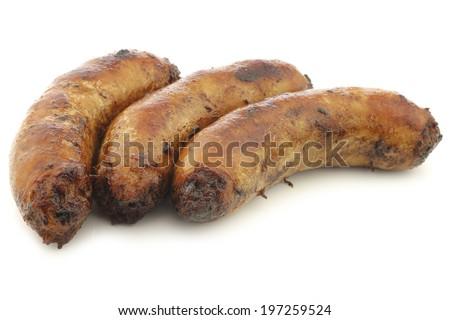 "freshly baked traditional sausage called ""bratwurst"" on a white background - stock photo"