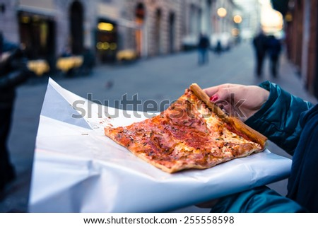 Freshly baked traditional savoury Italian pizza as a street food - stock photo