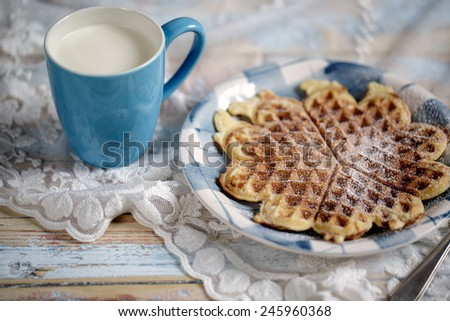 Freshly baked warm crisp Waffle with Icing sugar with Cup of Fresh Milk - stock photo