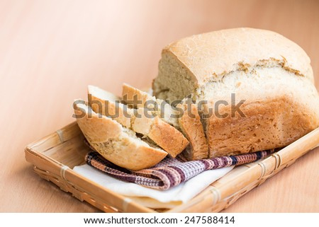 Freshly baked white bread on a wooden board