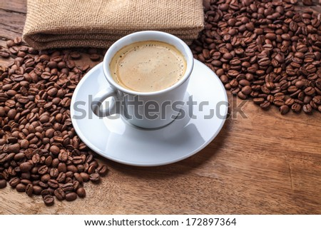 freshly brewed espresso on old wooden table