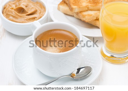 freshly brewed espresso, orange juice and toast for breakfast, close-up