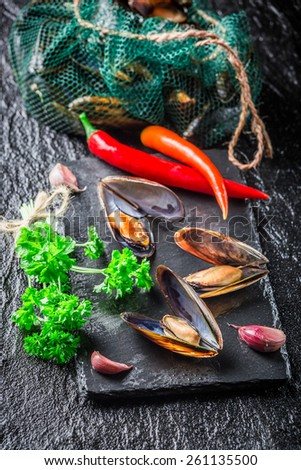 Freshly caught mussels on crushed ice - stock photo