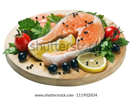 freshly caught salmon steaks with vegetables and spices for cooking on the grill. Can be used in cooking advertising in magazines and on the Internet for recipes. - stock photo