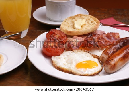 Freshly cooked breakfast with sausages and juice - stock photo
