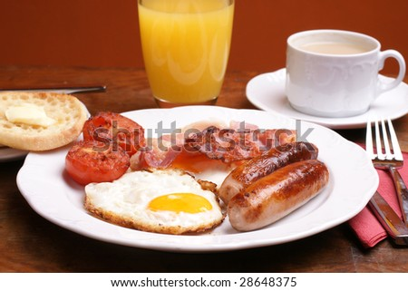 Freshly cooked breakfast with sausages and juice