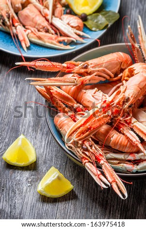 Freshly cooked scampi served with lemon - stock photo