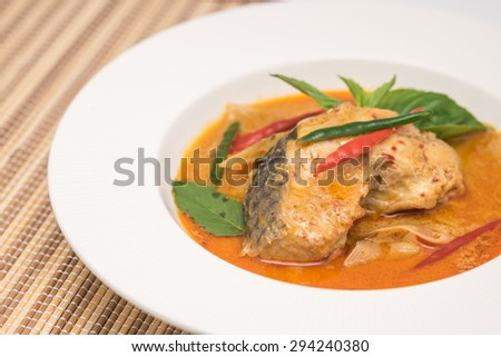 Freshly cooked Thai cuisine, sliced fish with spicy curry hot and spicy taste for local food background  - stock photo
