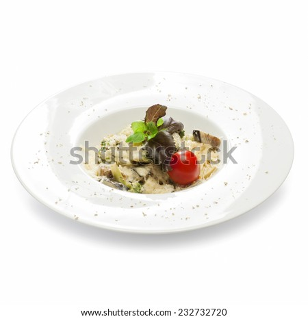 Freshly cooked vegetarian pasta with zucchini, broccoli, squash, basil, tomato and cheese on a plate on a white background - stock photo