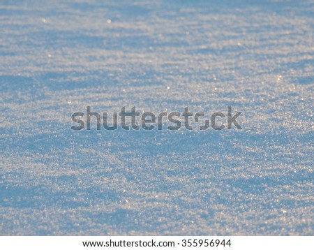 Freshly fallen snow in the early morning light - stock photo