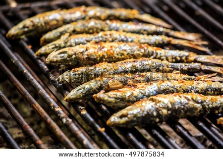 Freshly grilled sardines on the grill, Portugal