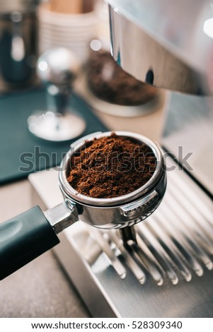 Freshly ground coffee in portafilter