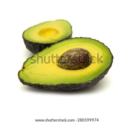 freshly halved avocado pear isolated on white background - stock photo