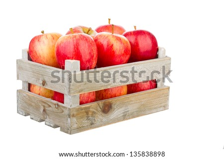 freshly harvested apples in a wooden crate isolated on a white background - stock photo