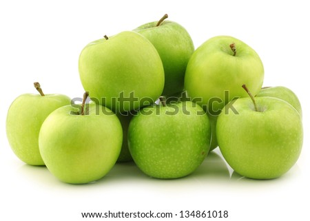 """freshly harvested """"Granny Smith"""" apples  on a white background - stock photo"""