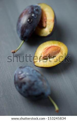 Freshly harvested organic plums, vertical shot - stock photo