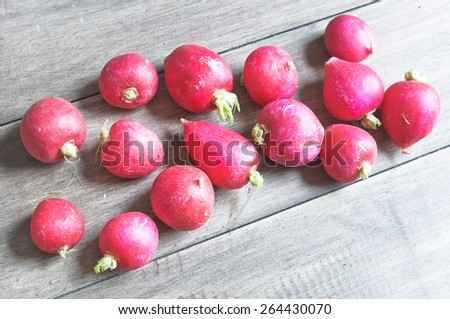 Freshly harvested radishes on a wooden surface - stock photo
