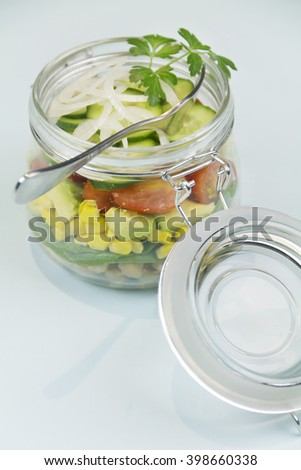 Freshly made garden salad served and presented in a glass jar. - stock photo