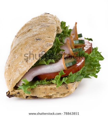 Freshly made ham and vegetable sandwich - isolated