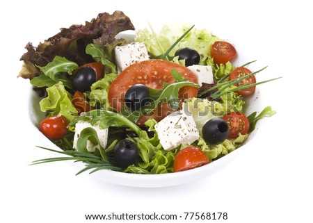 Freshly made salads with vegetable salad on front - stock photo