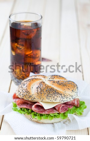 Freshly made sandwich with cold cut meat and lettuce