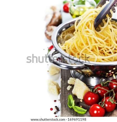Freshly made spaghetti with italian ingredients - stock photo