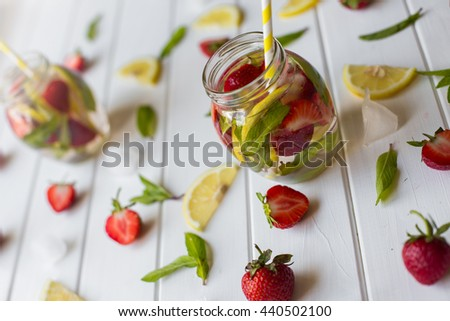 Freshly made strawberry mojitos with strawberry, mint, lemon and ice - stock photo
