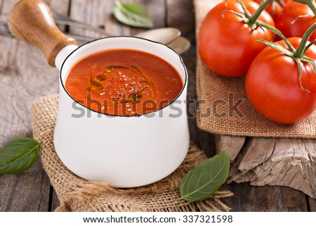 Freshly made tomato soup in a saucepan with olive oil - stock photo