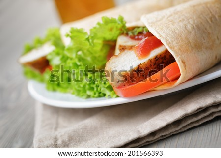 freshly made tortilla wraps with chicken and vegetables, rustic style