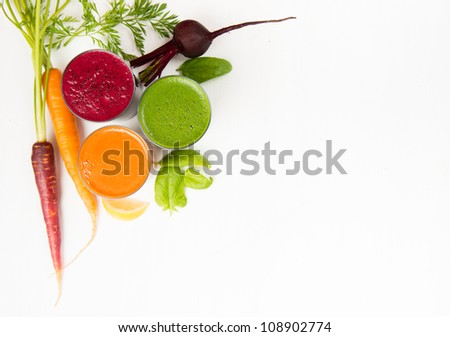 Freshly Made Vegetable Juices, Carrot, Beet, and Greens - stock photo