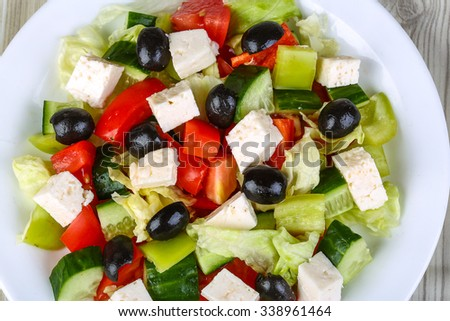 Freshly maked Greek salad with olive, cheese and vegetables