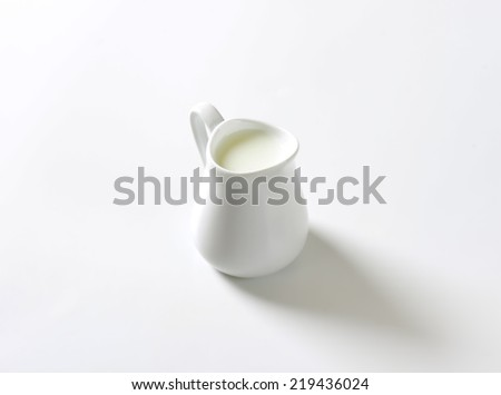freshly milked milk in the pure white ceramic jug