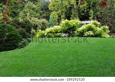Freshly Mown Lawn in a Beautiful Landscape Garden - stock photo