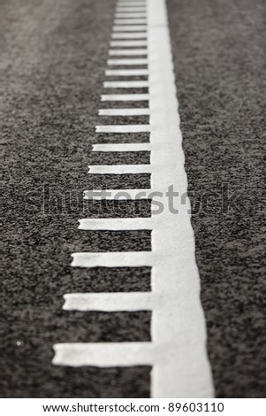 Freshly painted white lines on asphalt. - stock photo