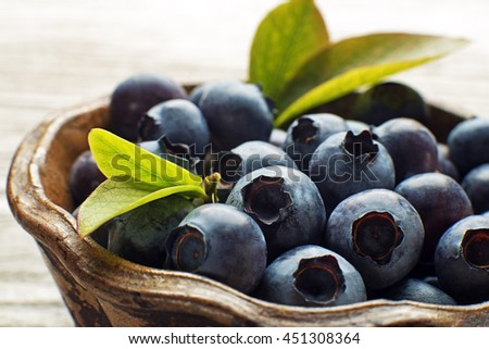 Freshly picked blueberries in bowl close up shoot