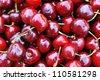 Freshly picked heap of sweet  cherries - stock photo