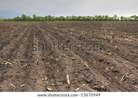 Plowed soil stock photos images pictures shutterstock for Rich soil definition