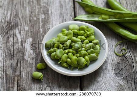 Freshly podded broad beans - stock photo