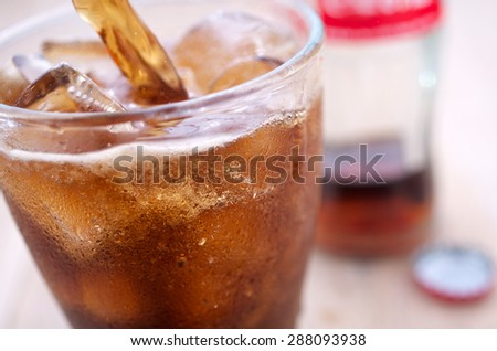 Freshly poured iced cola - stock photo