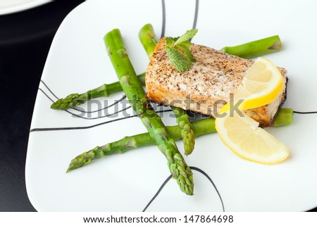 Freshly prepared salmon fish filet grilled and seasoned to perfection. - stock photo