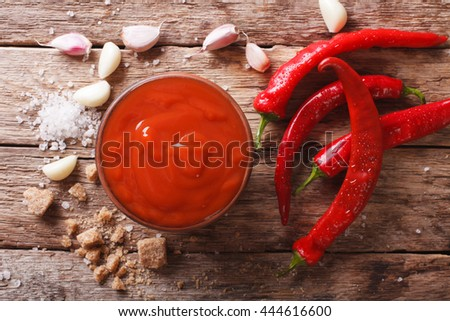 Freshly prepared Sriracha Hot chilli Sauce close-up on the table. horizontal view from above